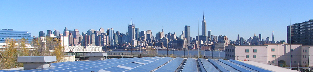 Adams Street WWTP Solar Panels on the Secondary Clarification Building with New York in the background in Hoboken